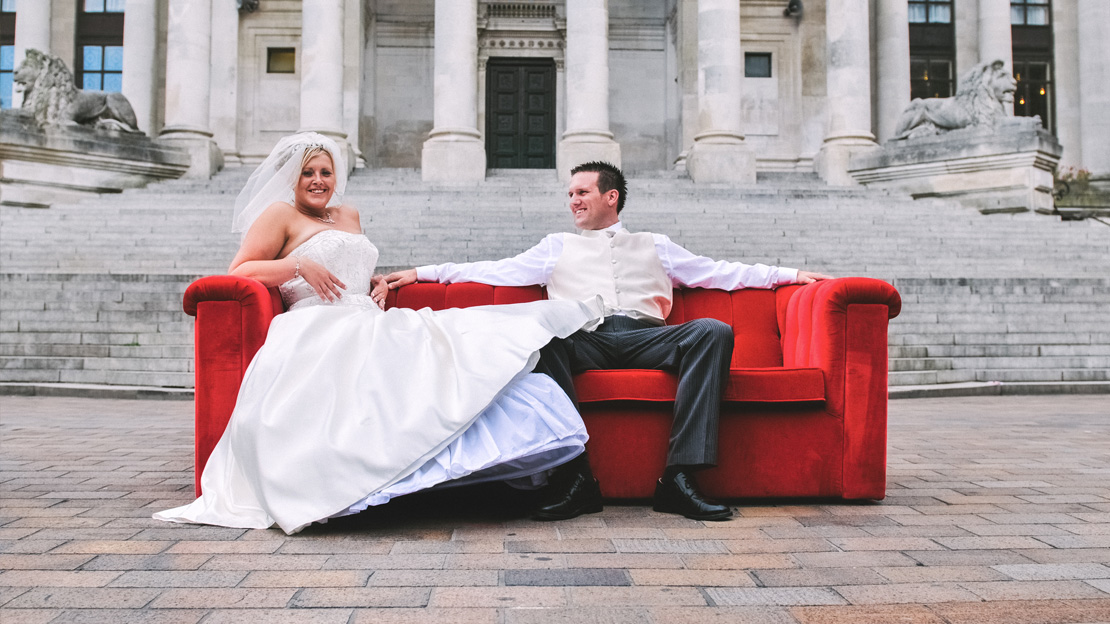 Relaxing on a red couch in front of the Guildhall - © Tokyo Magic Weddings
